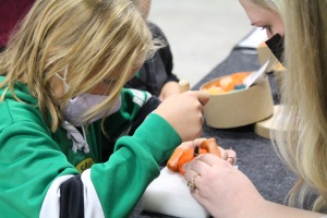 Stained Glass Artist, Bill Anthony, teaching a Festival attendee.